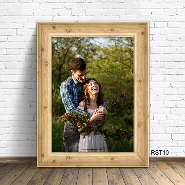 couple in rustic wood picture frame